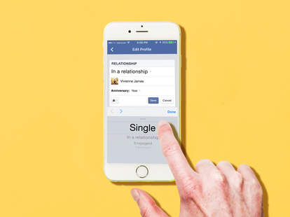 Finger changing relationship status to single on Facebook mobile on iPhone