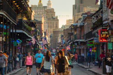 people walking down bourbon street in new orleans