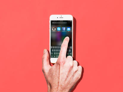 finger touching iPhone 6 screen