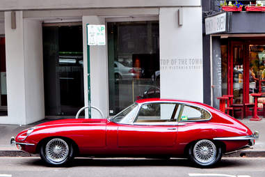 A Jaguar E-Type Sits on High Street