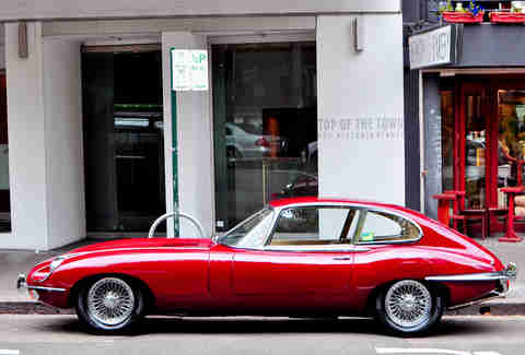 A Jaguar E-Type Sits on High Street