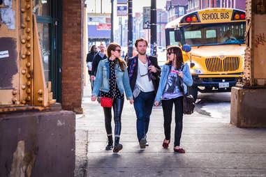Three friend strolling on a sidewalk