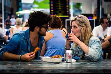 Couple conversing at street festival