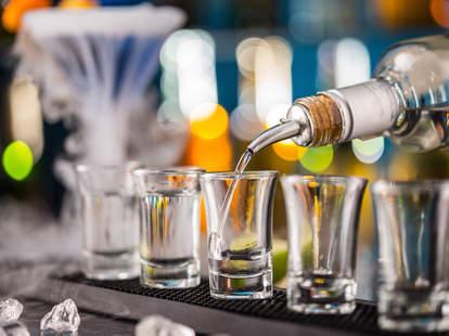 shots, shot glasses, bartender pouring shots