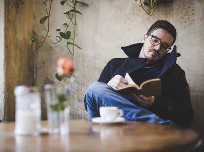 Man reading book by himself