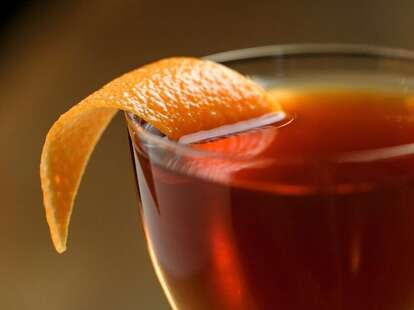 beverage with orange peel at Juniper Tar