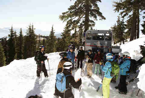 Skiers waiting outside Snowcat