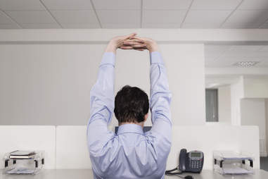 Office man stretching