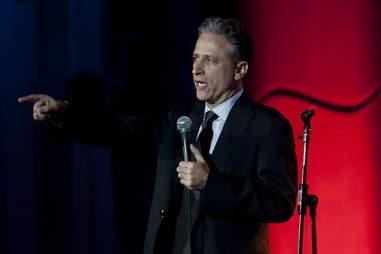 Jon Stewart with mic on stage