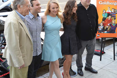 Wendi McLendon-Covey standing with cast