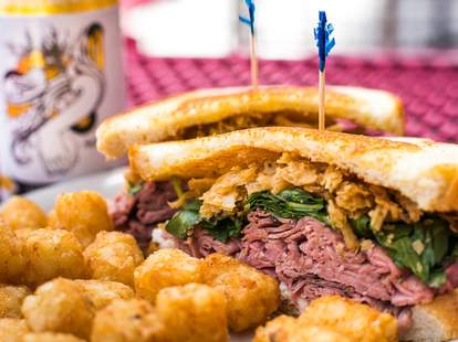 The Vortex Midtown sliced roast beef, blue cheese spread, balsamic glazed arugula, and french fried onion strings on grilled sourdough
