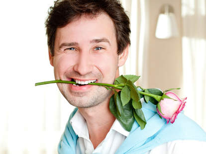 Man with flowers in his mouth