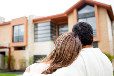 couple in the process of buying a house myths about happiness