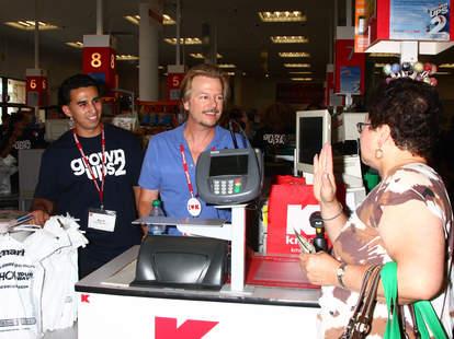 Fan talking to David Spade at register