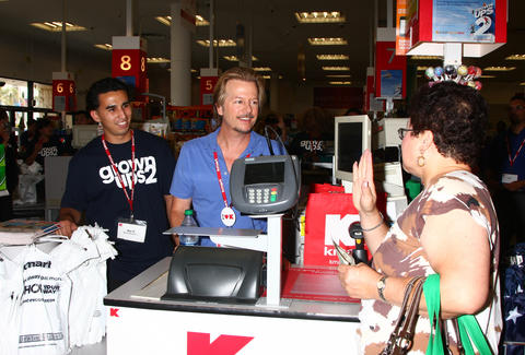 Fan talking to David Spade at register