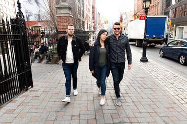 A couple walks down the road as a jealous friend follows