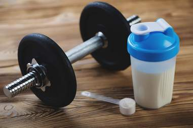 Protein shake with dumbbell