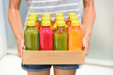 woman with juices for cleanse