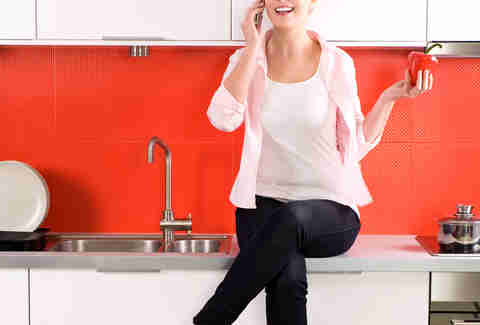 woman sitting on the kitchen counter