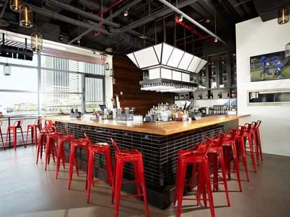 Bar and red stools at Watermark Bar NYC