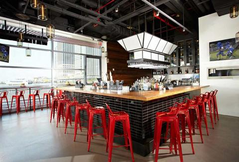 Bar and red stools at Watermark Bar NYC