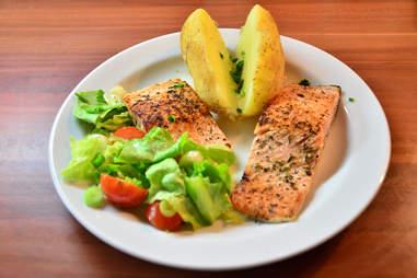 Salmon and lemon on plate