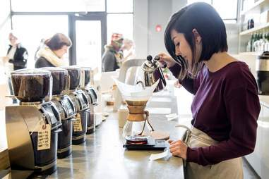 girl pouring coffee