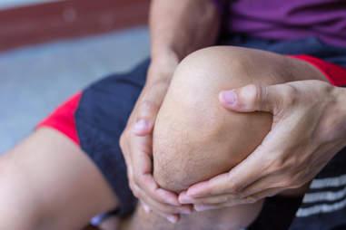 man with hurt knee