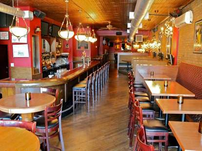 Waterhouse Tavern & Grill interior red cherry tables