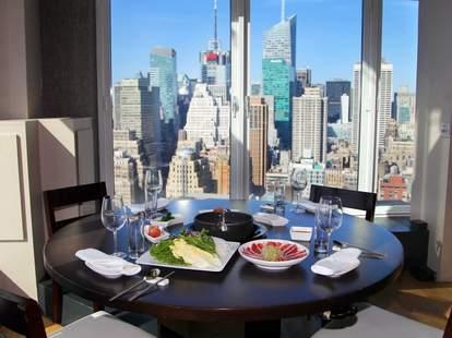 GAONNURI interior windows tables floor layout new york skyline view