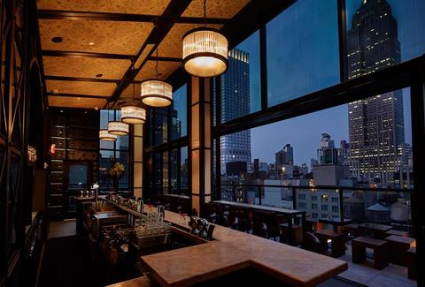 Spyglass Rooftop NYC interior floor to ceiling windows nyc skyline view