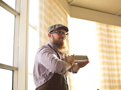 Austin Gurley of High & Tight Barbershop shaking a cocktail