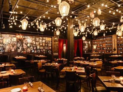 il Porcellino italian restaurant main room hanging lights frames on wall dark tables