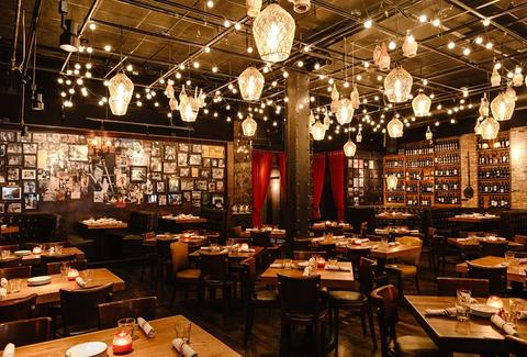 il Porcellino italian restaurant main room hanging lights frames on wall dark tables