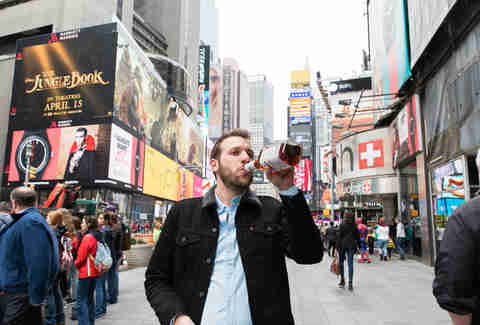 Man drinking in Times Square