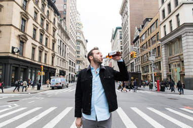 Man drinking in the middle of Fifth Avenue