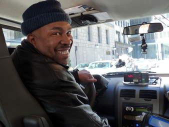 Cab driver smiling