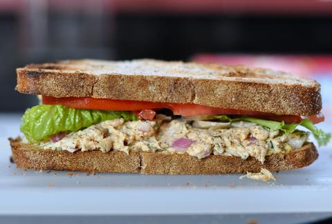 sandwich with toasted bread, lettuce, tomato, and trout