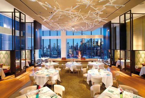 Mandarin Oriental, New York dining room new york skyline floor to ceiling windows