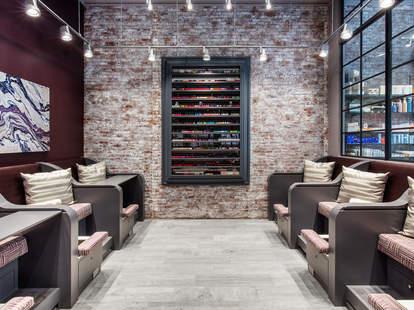 Haven Spa exposed brick lounge chairs soho nail polish wall