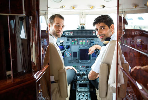 airplane pilots in the cockpit