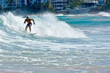 El Rincón beach surfer in Puerto Rico