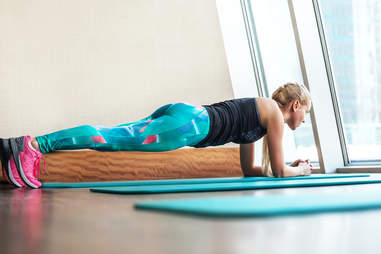woman doing plank stretch exercise gym