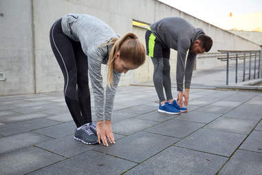 couple touching their toes stretching exercise