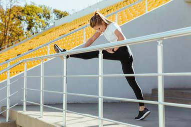 woman stretching outside leg stretch