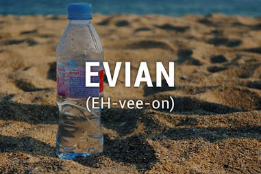 Bottle evian on sand
