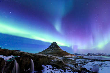 Kirkjufell mountain in Iceland with Northern Lights