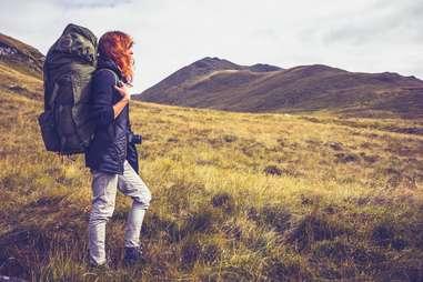 woman hiking outside alone travel