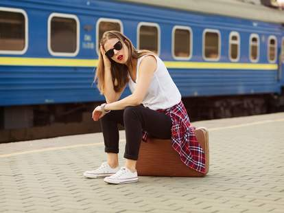 woman frustrated waiting for a train