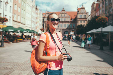 woman with camera travel